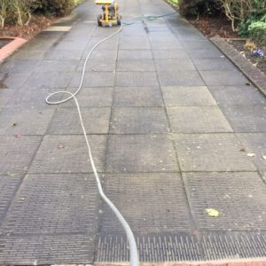 paved area in the process of being cleaned